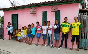 PIC BY ROBSON COELHO / CATERS NEWS - (PICTURED:Family with thirteen boys that live in Brazil) - Meet the Brazilian couple with 13 sons, who wont stop until they have a daughter. Irineu Cruz and his wife Jucicleide Silva, who have been trying for a girl for nearly two decades, have enough sons to make up their own football team. The brood ranges from one-month to 18-years-old and the couple say they wont stop trying until a girl arrives. When Jucicleide first got pregnant, husband and wife decided mum would name the girls and Irineu would name the boys. Footie-mad dad has since christened all 13 boys after famous footballers - all beginning with the letter R. The family who live in Conceiao de Coit, in north east Brazil, hoped their thirteenth child would be a game-changer but instead the midwife announced it was yet another boy. SEE CATERS COPY