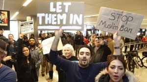 Supporters cheer as an Iranian citizen with a valid US visa arrives at Los Angeles International Airport.